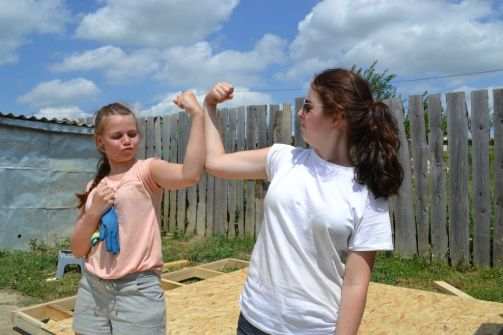 Laura and Elease showing off their muscles